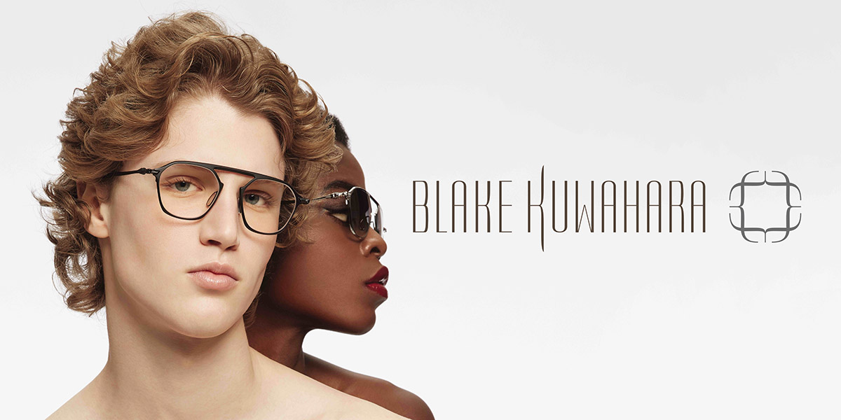 Male and female model wearing unique eyewear. A solid colored frame is encased in a clear outer frame.